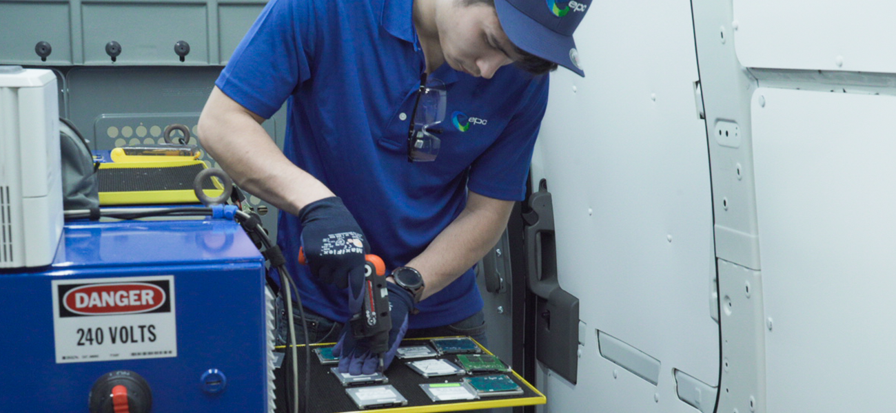 Technician removing chassis from Solid state hard drives
